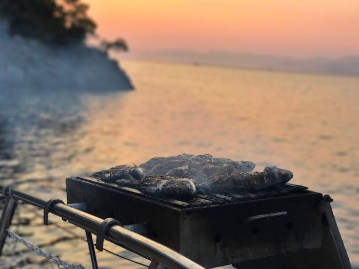 Beach Sea Outdoors Water Nature Sand Sunset No People Beauty In Nature Barbecue Day Close-up Sky Fish BBQ Grill Fethiye Mavi Yolculuk