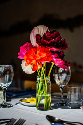 Close-up of roses in glass vase on table