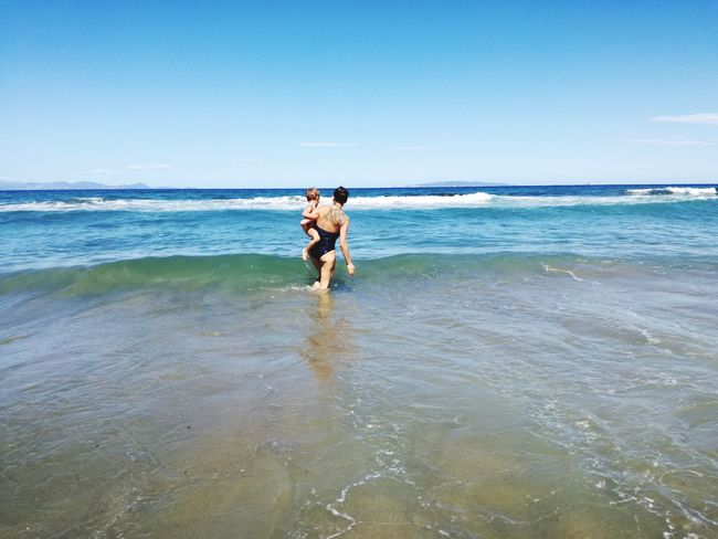 EyeEm Selects Beach Sea Full Length Vacations Walking Two People Sand Day Fun Outdoors Sky Horizon Over Water Mum And Son Across The Universe Across The Sea