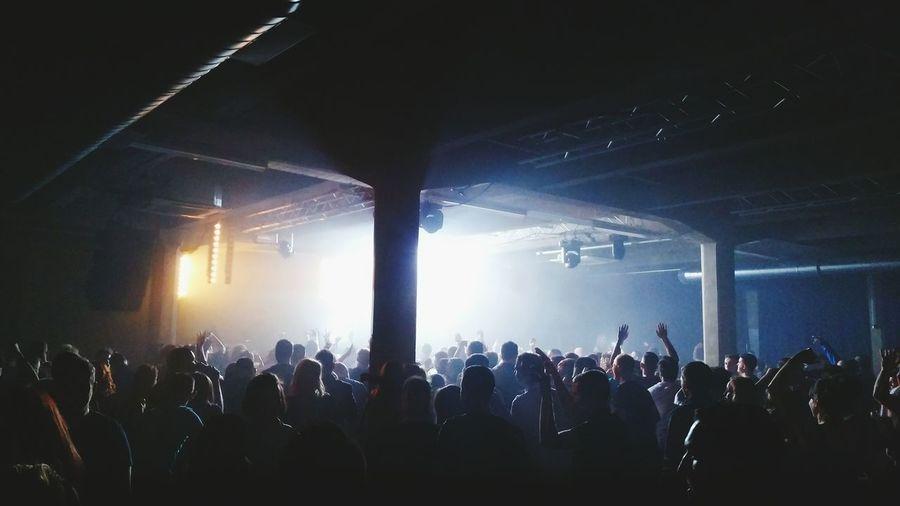 People enjoying at illuminated concert