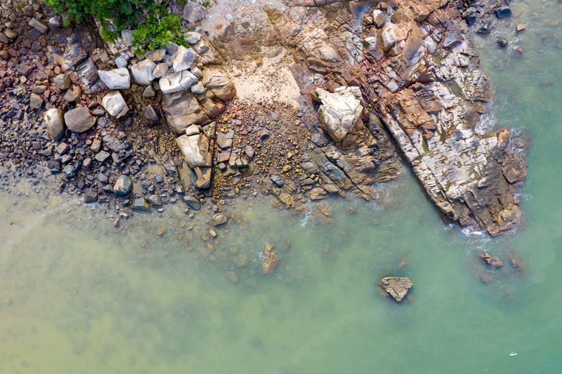 High angle view of rock formation in lake