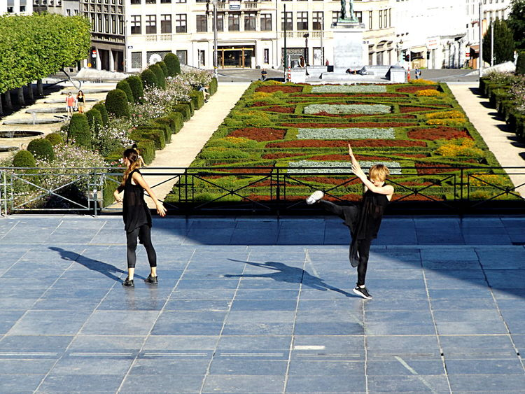 Act 8. Dancers Mouvement Artistique Showing Emotion Togetherness Duo Dancers Young Women Front View City Life City Outdoors Streetphotography Architecture Movement In The Picture Backpack Light And Shadow Visitbrussels Duo Two Is Better Than One