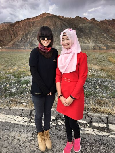 Mountain Full Length Portrait Togetherness Looking At Camera Leisure Activity Casual Clothing Lifestyles Bonding Standing Front View Young Adult Person Non-urban Scene Mountain Range Vacations Tourism Scenics Beauty In Nature Day