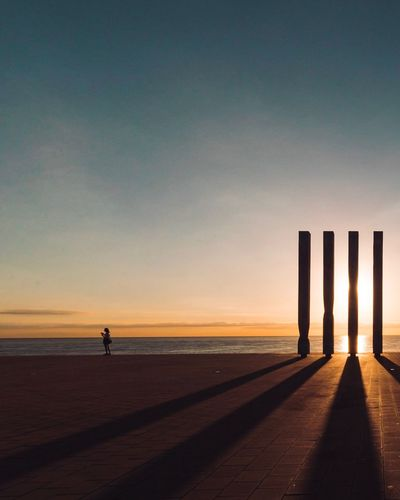 EyeEm Selects Sunset Sea Silhouette Beach Scenics Horizon Over Water Nature Water Sky Tranquil Scene Beauty In Nature Sand Outdoors Sunlight Tranquility Idyllic Travel Destinations Vacations Real People Clear Sky Barcelona Sunrise