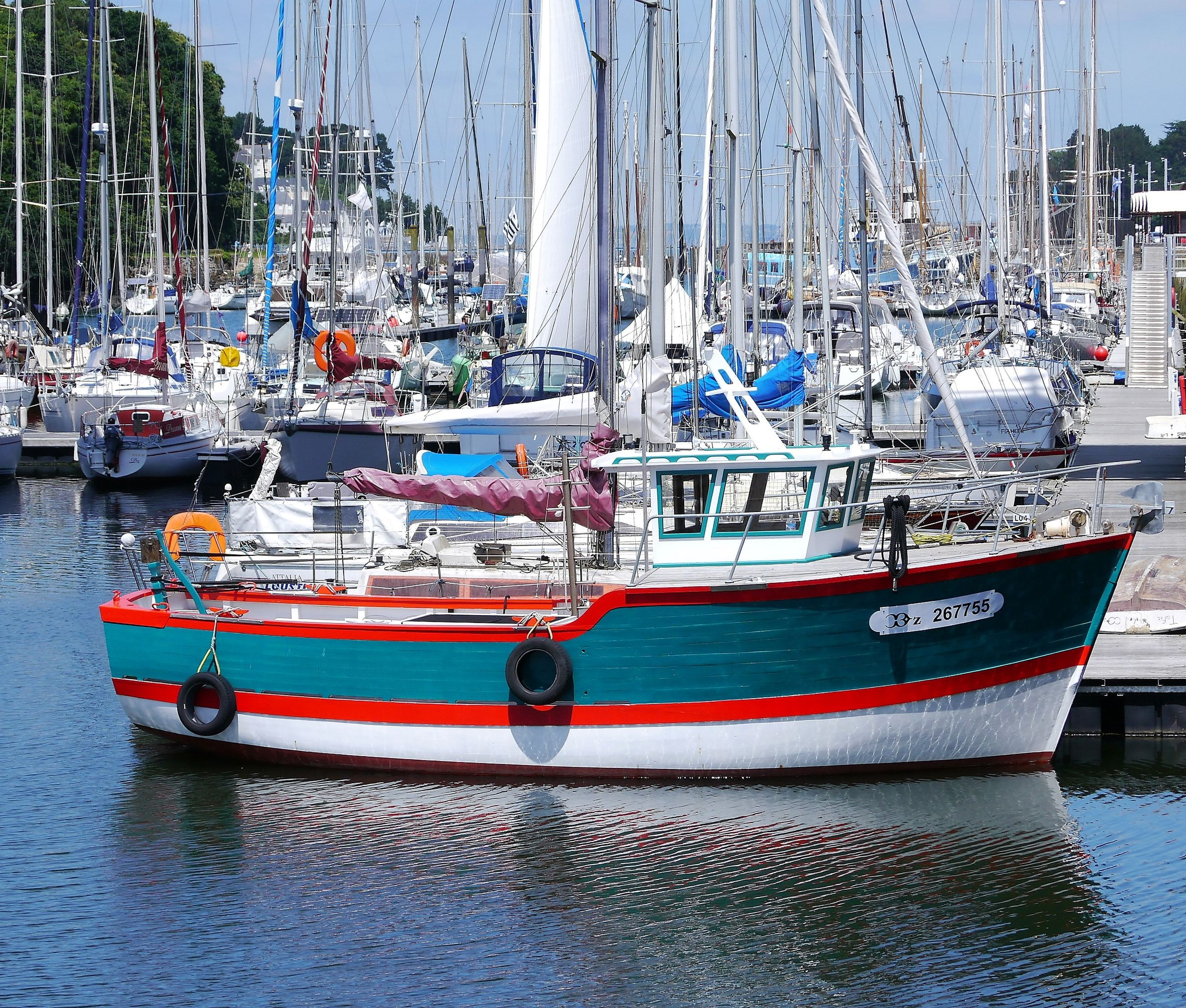 transportation, nautical vessel, mode of transport, moored, boat, waterfront, water, mast, city, sailboat, tranquility, day, outdoors, scenics, nature, harbor, sky, tranquil scene, sea, no people, tall - high, city life