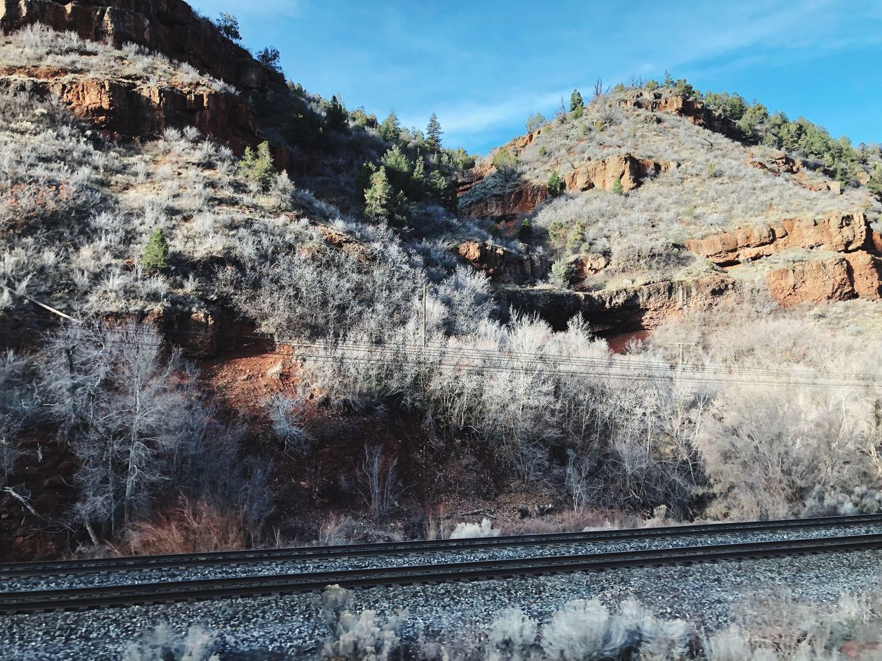 mountain, no people, sky, nature, rail transportation, day, railroad track, built structure, architecture, tree, track, plant, beauty in nature, travel, cloud - sky, rock, building exterior, rock formation, outdoors, wall, formation