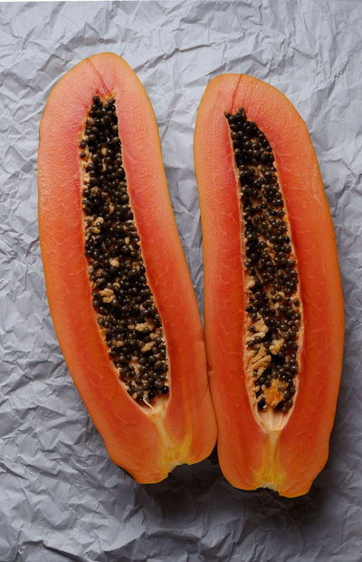 Close-up Cut In Half Day Food Food And Drink Freshness Halved Healthy Eating High Angle View Indoors  No People Orange Color Papaya Ready-to-eat Ripe Fruit Seed Tropical Fruit Vivid