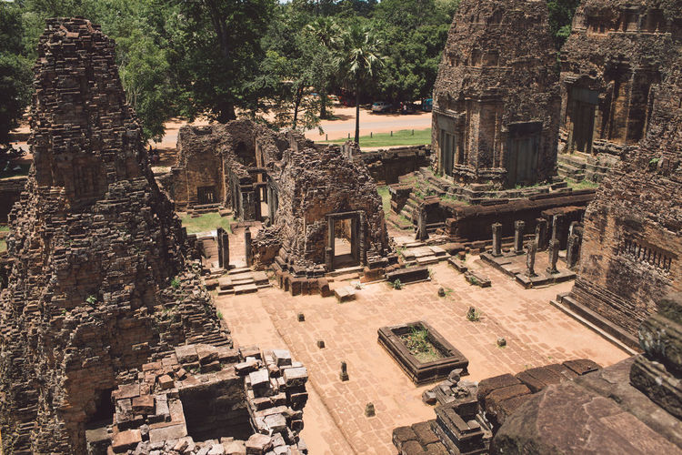 Siem Reap Cambodia Angkor Architecture Built Structure History The Past Ancient Travel Destinations Old Ruin Tourism Religion Building Exterior Ancient Civilization Day Travel Belief Building Tree Spirituality Old Place Of Worship No People Archaeology Outdoors Ruined Architectural Column Deterioration