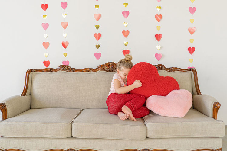 Girl sitting on sofa at home