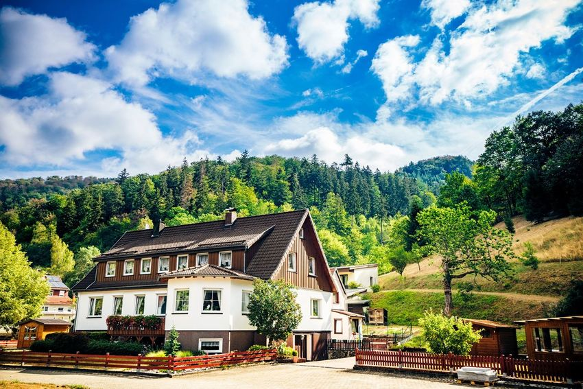 German cottage in the summer with a beautiful blue sky Rural Mountains Travel Summer Alps Countryside Blue Sky Cottage House Germany Architecture Built Structure Building Exterior Cloud - Sky Building Sky Tree Nature No People House Residential District Day Outdoors Blue Sunlight City Land Roof Growth Plant