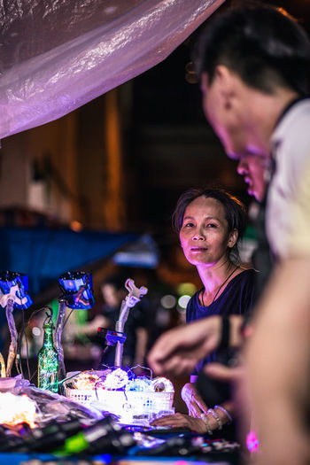 Night Lights Portrait Of A Woman Portrait Photography Streetphotography Street Photography Old Woman Elderly Elderly Woman Street Vendor Hong Kong Vendor Working Class Night Market ASIA Illuminated Cultures Women Close-up The Photojournalist - 2018 EyeEm Awards