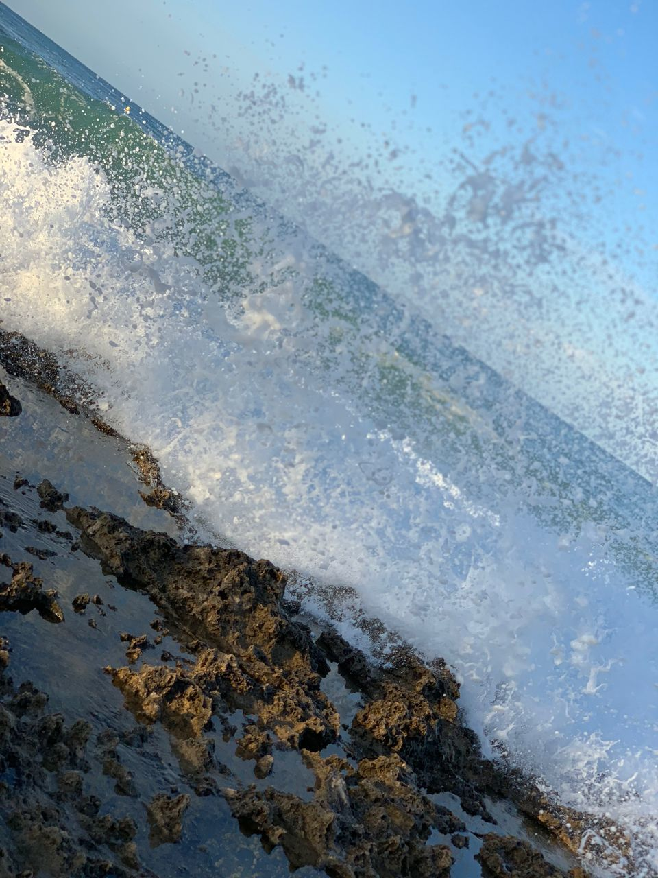 water, nature, no people, day, sea, motion, high angle view, beauty in nature, land, outdoors, sport, wet, splashing, aquatic sport, beach, waterfront, wave, power in nature, purity, flowing