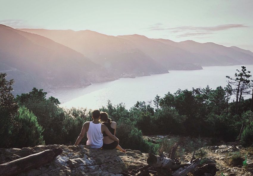 Soulmates Lost In The Landscape Real People Mountain Nature Sitting Rear View Beauty In Nature Leisure Activity Two People Scenics Mountain Range Tranquility Tranquil Scene Outdoors Morning Morning Light Togetherness Landscape Water Day Mountain View Couple