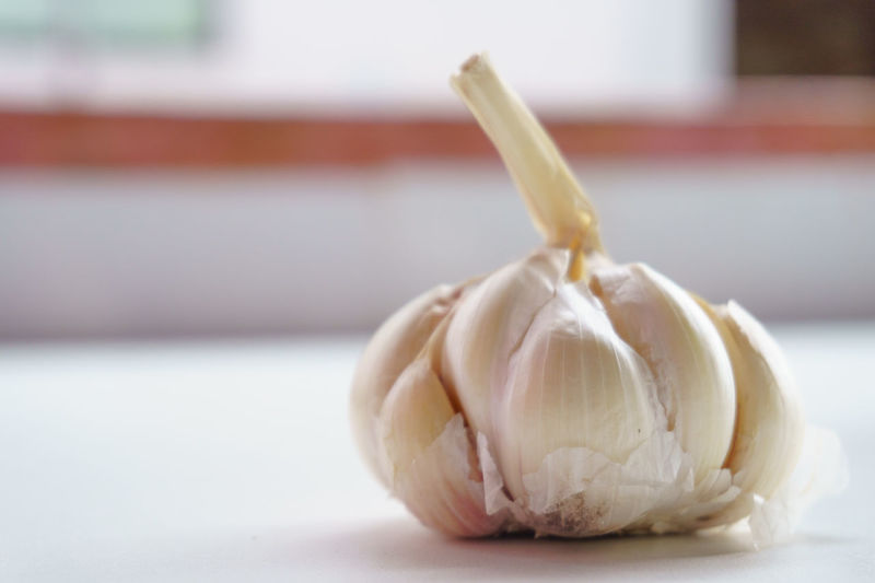 Close-Up Of Garlic Bulb On Table