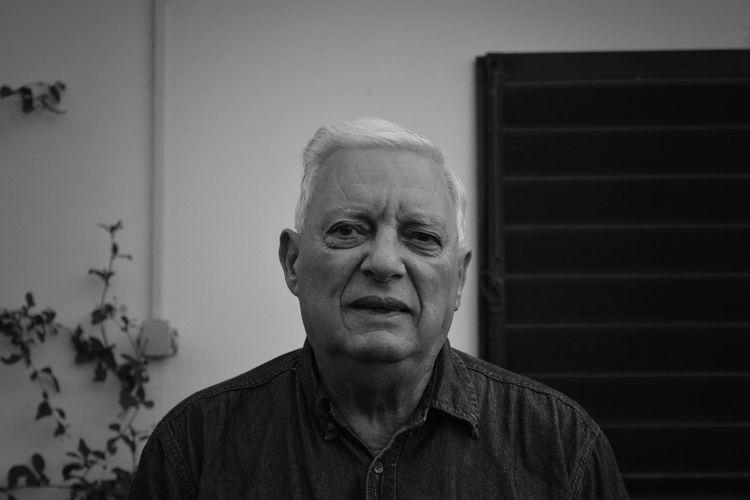 Portrait Of Senior Man Against House