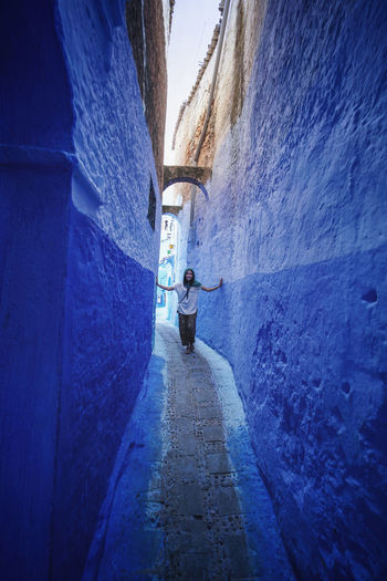 """""""The Blue City"""" - Chefchaouen, Morocco. Chefchaouen Chefchaouen Medina Medina Morocco MoroccoTrip EyeEmNewHere a new beginning Digital Nomad Travel Travel Destinations Traveling Travel Photography Photography Blue City Alley Maze Arabic Moroccans Tourism Tourist Attraction  Tourist Destination One Person Real People Architecture The Way Forward Rear View Built Structure Full Length Day Direction Lifestyles Walking Wall - Building Feature Men Leisure Activity Wall Outdoors Building Exterior Building Footpath"""