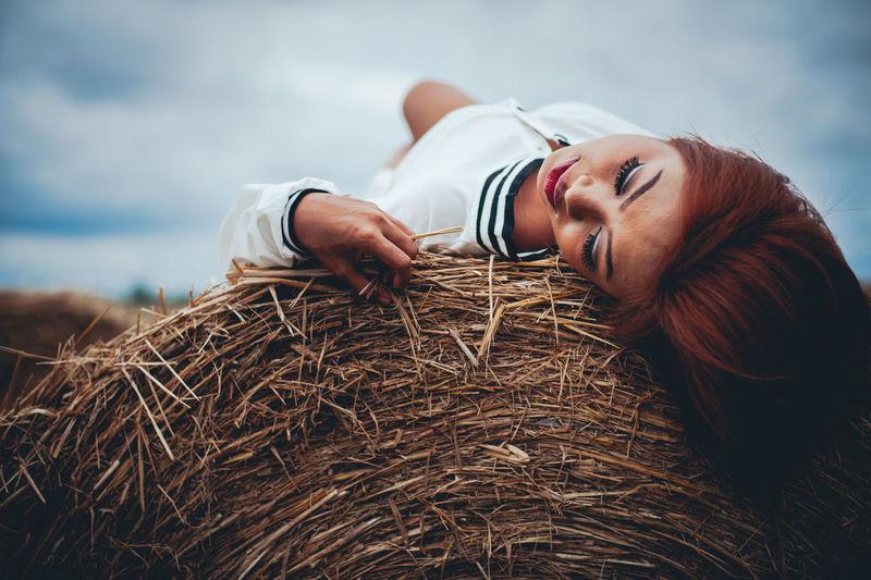 Woman lying down on field