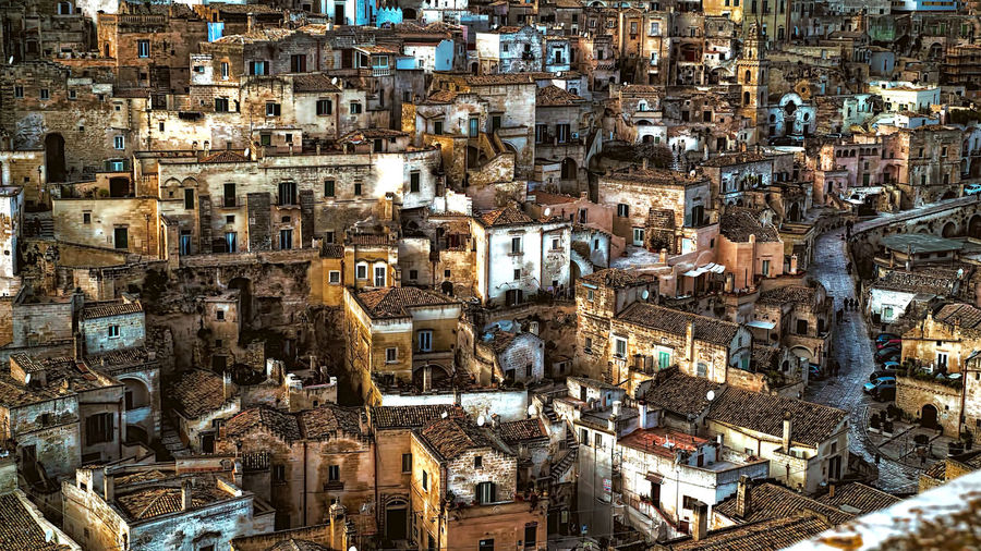 HIGH ANGLE VIEW OF OLD HOUSES IN MATERA, ITALY