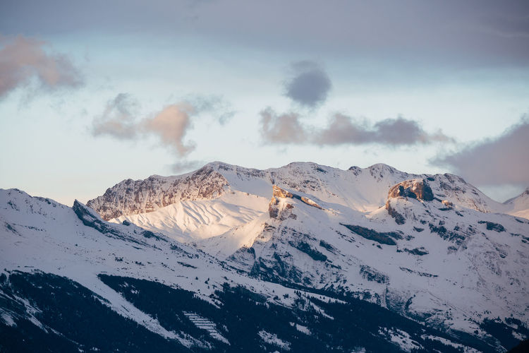 Summits of the swiss alps at dusk in the canton of valais, switzerland.