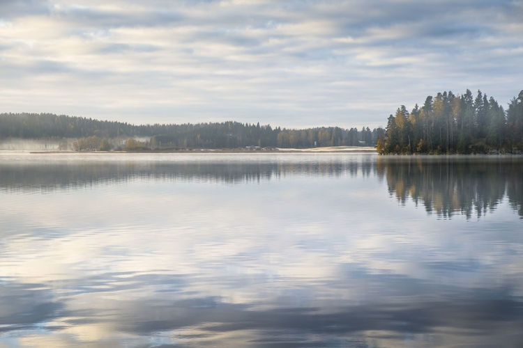 Scenic landscape with lake and morning light Beauty In Nature Cloud - Sky Focus On Foreground Fog Idyllic Lake Landscape Lifestyles Light Morning Mountain Nature No People Outdoors Peaceful Portrait Reflection Reflection Lake Scenics Sky Sun Tranquil Scene Tranquility Tree Water