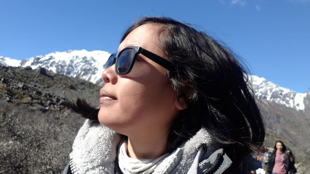 EyeEm Selects Mountain Sunglasses Headshot One Person People Only Women One Woman Only Sunny Day Mountain Range Sunlight Outdoors Adult Nature Vacations Adults Only Sky Portrait Snow Adventure New Zealand Close-up Fox Glacier