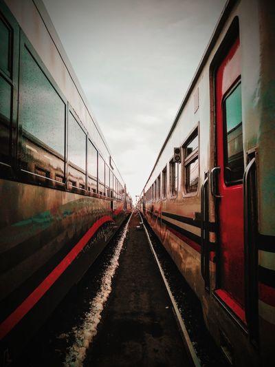 Train on railroad tracks against sky