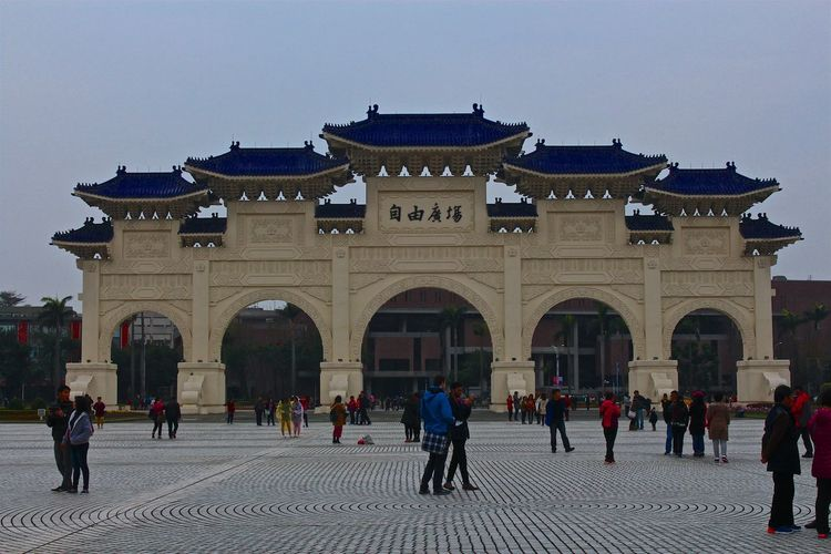 People Visiting Chiang Kai-Shek Memorial Hall Against Clear Sky