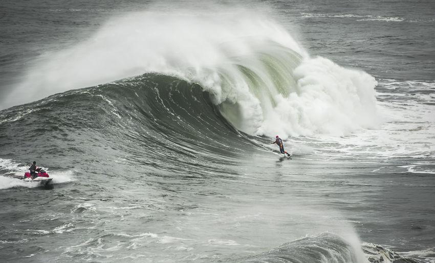 High angle view of people enjoying sea waves