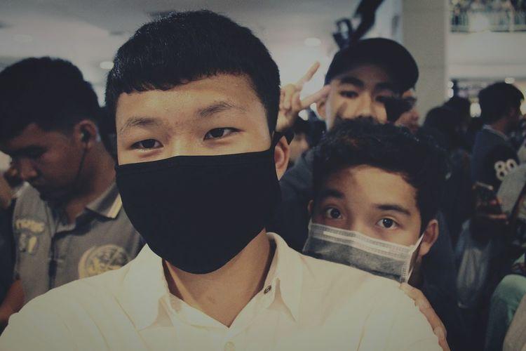 Portrait of men wearing pollution masks