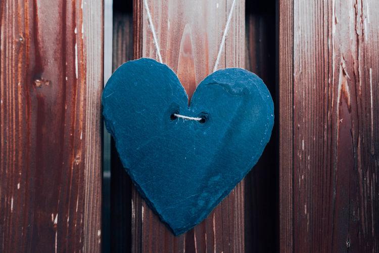 Close-up of heart shape on wooden door