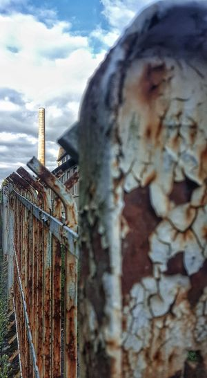 Rusty fence in Luxembourg Wiltz Cloud - Sky Sky Outdoors No People Close-up Architecture Tranquil SceneEyeEm Selects Eyeemphotography EyeEmNewHere EyeEm Best Shots Tranquility Luxembourg Luxembourg Streetphotography Fence Rusty Rusty Metal EyeEm Nature Lover EyeEm Best Shots - Landscape