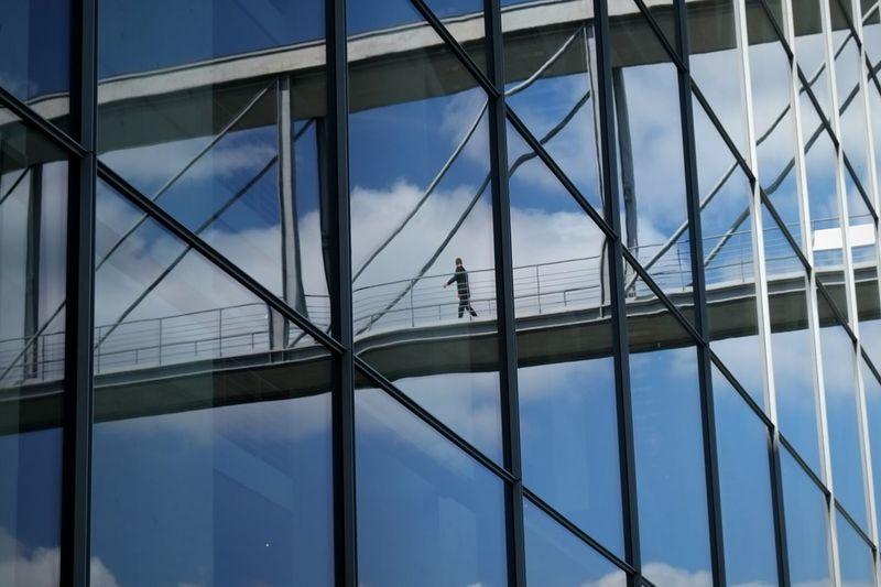 Reflection of pedestrian bridge on building window