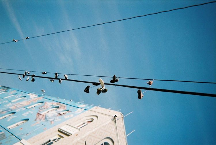 Sneaker Sneakers Kicks EyeEm Selects Cable Electricity  Low Angle View Power Line  Sky