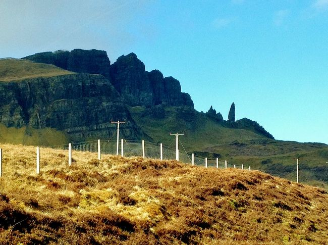 Beauty In Nature Blue Clear Sky Day Field Grass Grassy Hill Idyllic Landscape Mountain Mountain Range Nature No People Non Urban Scene Non-urban Scene Old Man Of Storr Outdoors Plant Remote Scenics Sky Skye Tranquil Scene Tranquility