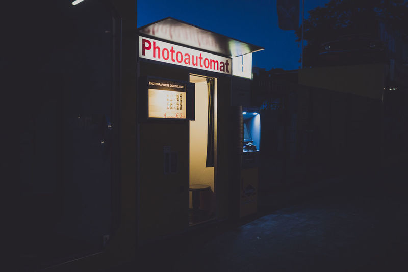 Architecture Built Structure City Dark Empty Illuminated Information Information Sign Night No People Outdoors Photoautomat Road Sign Sky