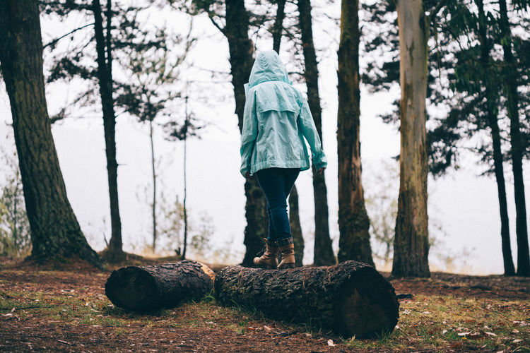 Rainy Days Winter Day Forest Forest Trees Full Length Men Nature One Person Outdoors People Raincoat Real People Tree Tree Trunk Vintage Lost In The Landscape Women Woman EyeEmNewHere Connected By Travel Springtime Decadence