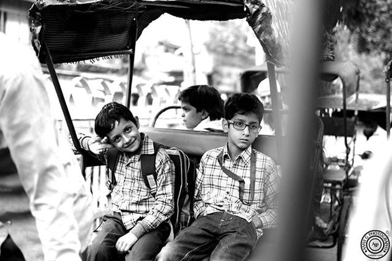 ©Amvi G Photography Grin of a child ; Intentness of a Grown Up.. EXIF: D5300 - Nikon 35mm VR lens Shutter Speed : 1/200 Aperture : f/1.8 ISO : 100 Focal Length : 35.0 mm Photographer Photography Chandnichowk Schoolboys Iamnikon Nikonschool D5300 Candid Amvigphotography Monochrome Delhighted DelhiGram