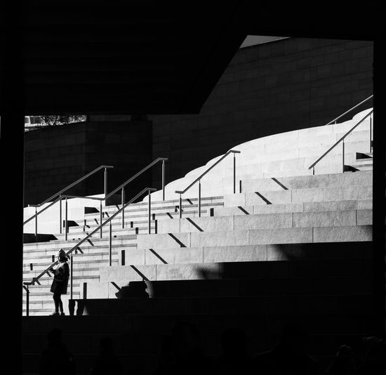 Steps in a shopping centre, Liverpool One, in brilliant winter sunshine Black And White Blackandwhite Railings Real People Shadow Staircase Steps Steps And Staircases Street Photography Streetphotography