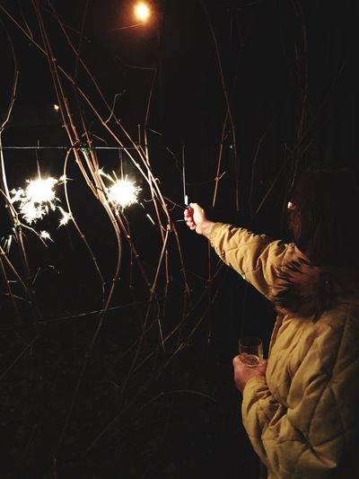 Happy New Year Lighter Grape Vine Vine Light Woman Love Holiday Winter Happy People Family 2019 New Year Celebration Happy New Year Happy New Year 2019 One Person Human Hand Glowing Celebration Outdoors Hand Holding Motion Long Exposure Sparkler Sparks Firework