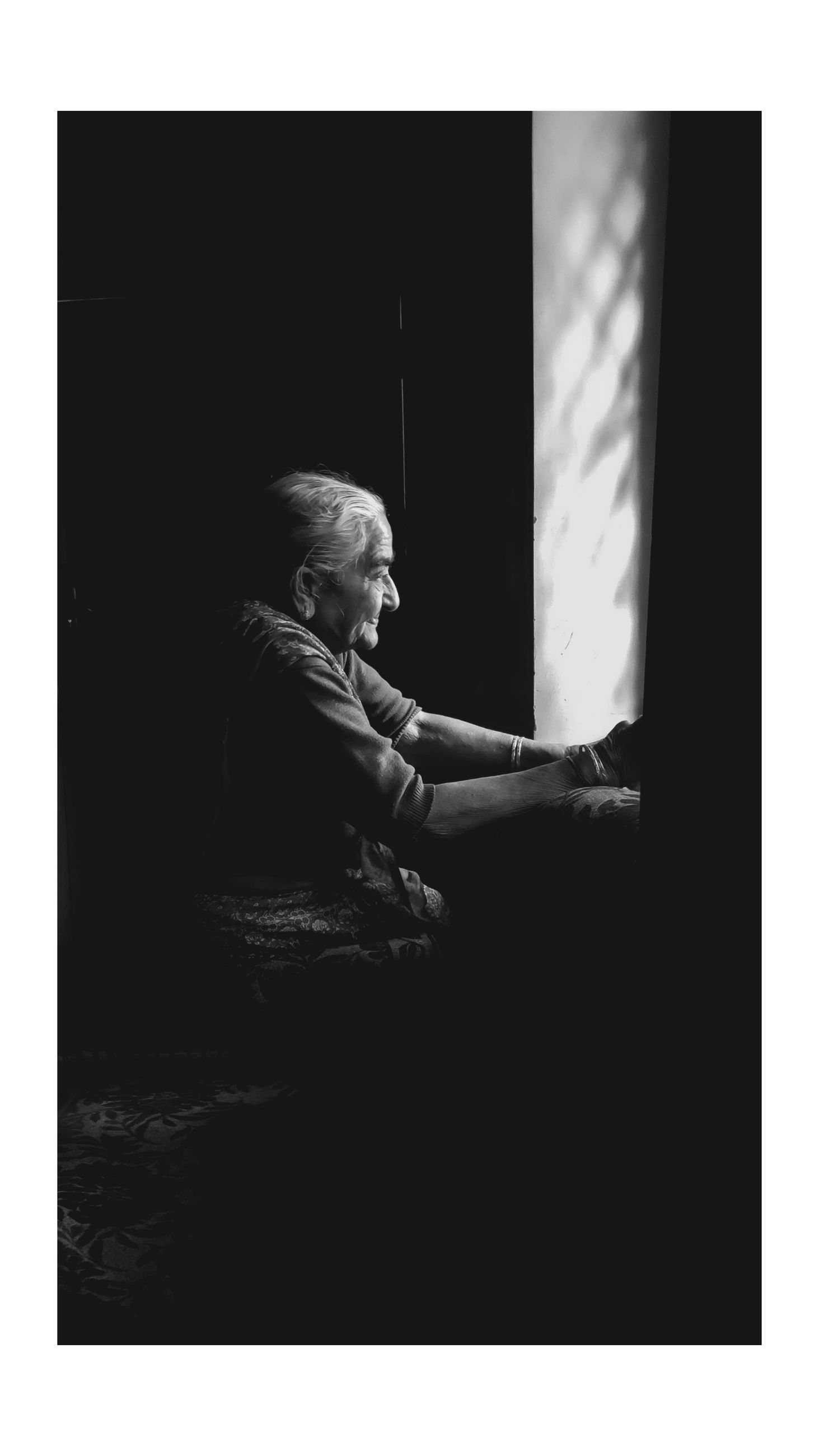 one person, auto post production filter, transfer print, women, real people, adult, lifestyles, indoors, sitting, side view, copy space, relaxation, leisure activity, three quarter length, females, casual clothing, studio shot, looking, contemplation, black background, profile view