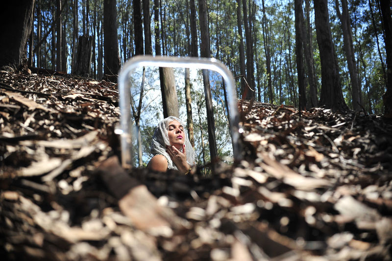 Reflection Of Woman On Mirror In Forest