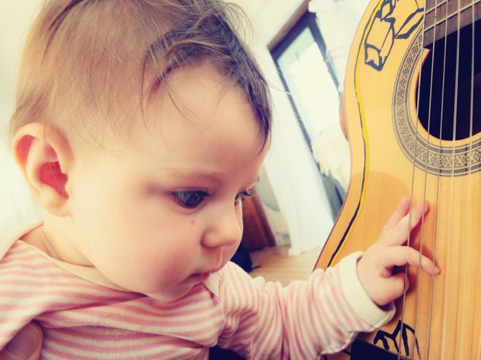 baby is playing the guitar Musical Instrument Guitar Arts Culture And Entertainment Acoustic Guitar Sound Skill  Learning Discover  Playing Baby Strings Tone Toddler  Toddlerlife Real People Child Childhood One Person Baby Indoors  Young Cute Portrait Babyhood Music Leisure Activity String Instrument