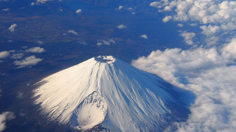 Top view of Mt. Fuji mountain and clouds and clear clean blue sky. Beauty In Nature Day Fuji Fujiyama Hig Angle View Hill; Clear; Bird; White; Cloud; Travel; View; Landmark; Scenery; Mount; Morning; Top; Asia; Ice; Dove; San; Window; World; Famous; Airplane; High; Mt; Close; Winter; Blue; Mountain; Fuji; Sky; Capped; Highest; Background; Beautiful; Snow; Peak; Nature; J  Nature No People Outdoors Scenics Sky Snow