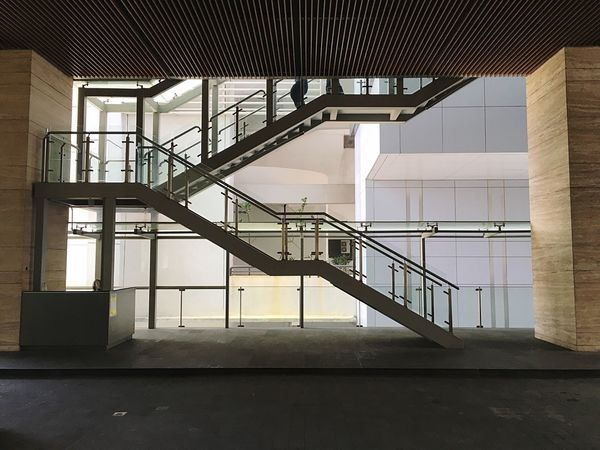 People Staircase Railing Architecture Steps And Staircases Built Structure No People Indoors  Day Spiral Staircase Metal Business Finance And Industry Spiral Building Industry Modern Window City