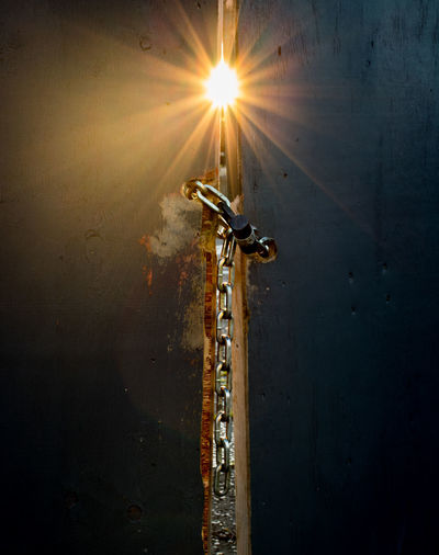 Gold Sun Star Ajar Chain Close-up Day Door Falling Glowing Illuminated Indoors  Lens Flare Lock Metal Mystery No People Open Padlock Safety Security Sky Sun Sunbeam Sunlight Wall - Building Feature