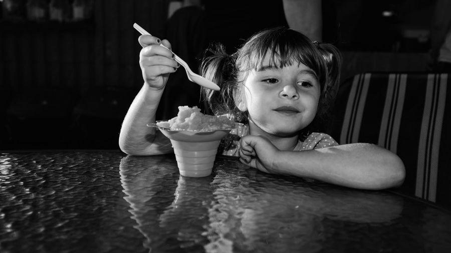 Cute girl having food at restaurant