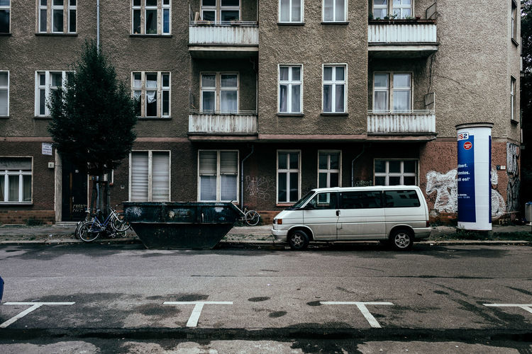 Cars parked in front of residential buildings