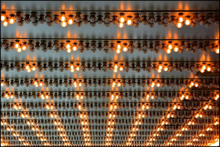 Low Angle View Of Illuminated Theatre Lights At Ceiling