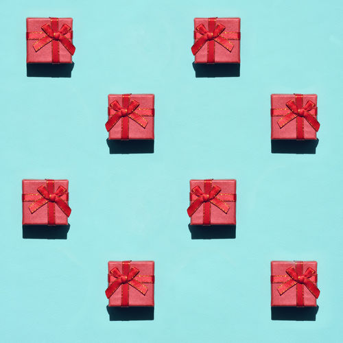 Directly above shot of gifts on blue background