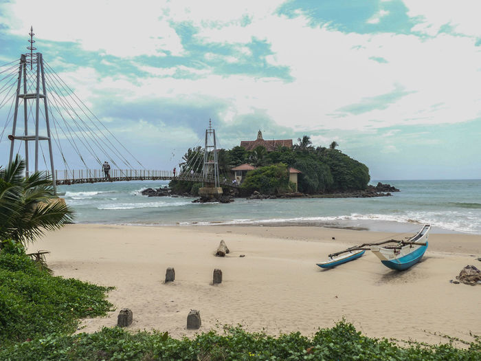 Matara Architecture Beach Beauty In Nature Bridge Bridge - Man Made Structure Built Structure Cloud - Sky Day Horizon Over Water Nature Nautical Vessel No People Outdoors Sand Scenics Sea Shore Sky Tranquility Travel Destinations Tree Water